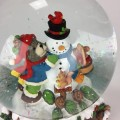 Snow globe bear and snowman